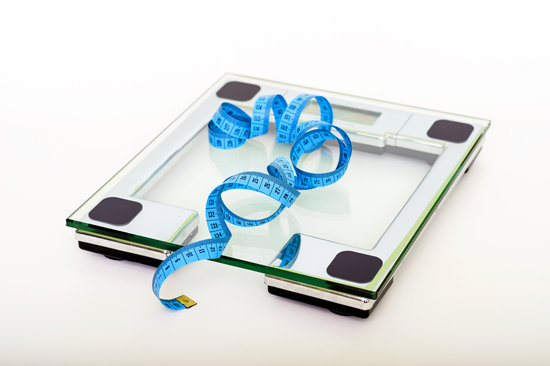 canva-blue-tape-measuring-on-clear-glass-square-weighing-scale-MADGyLIsXWA